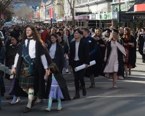 The University of Otago graduation parade moves along George St on Saturday afternoon. Photos:...