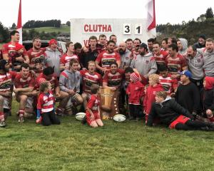 The Clutha team and supporters celebrate after beating Upper Clutha 31-28 in Balclutha on...