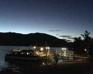 Sunset seemed so much later this far west, looking across Te Anau to the Kepler Mountains and the...
