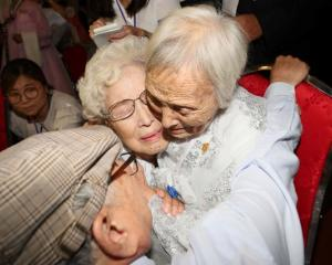 North and South Korean family members meet during a reunion at North Korea's Mount Kumgang resort...