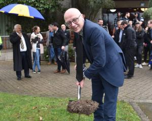 University of Otago humanities pro-vice-chancellor Prof Tony Ballantyne turns the sod at a...