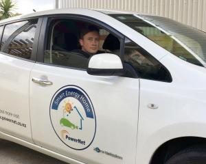 Cam Waru takes the electric vehicle loaned to his family for a spin. PHOTO: SHARON REECE