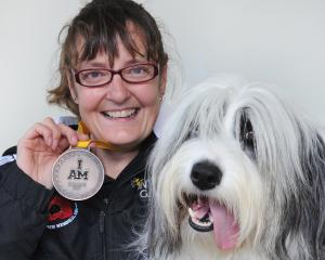"Invictus Games bronze medallist Nicki Fairbairn and her ""anti-depressant dog'' Kobi at her home yesterday. Photo: Christine O'Connor."