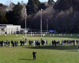A large crowd watches the action between Otago Boys' High School and John McGlashan College...