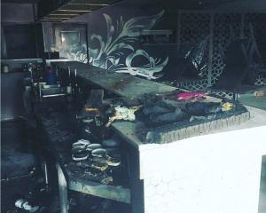 It is believed tea towels under the bar (pictured) caused the fire at Ode restaurant on Sunday...
