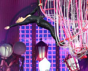 Pink performs suspended above the stage atop a chandelier at Perth Arena on July 3. Photo: Getty...