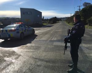 Police have blocked SH1 south of Owaka. Photo: Richard Davison
