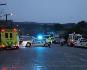 Police at the scene of an incident at Gorton St, Gore this evening. Photo: Ashleigh Martin