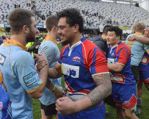 Harbour's Chris Schaaf (right) and University's Calvin Vari embrace after Saturday's drawn...