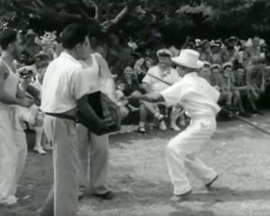 A still from the New Zealand National Film Unit clip, that shows Samuela Ariki, all in white,...