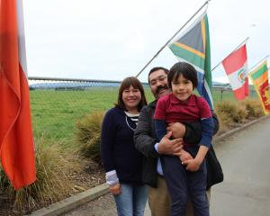 At Clutha Valley Primary School are Merry Salazar, Francisco Martin (middle) and their son Pierre...