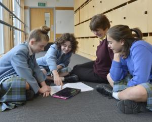 Margie Rogers takes part in a year 8 music class at St Hilda's Collegiate with pupils (from left)...