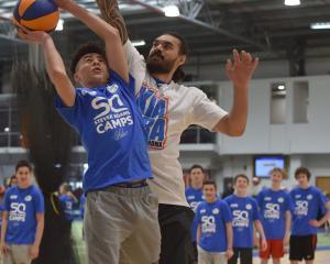 Steven Adams in action with Waitaki Boys' High School pupil Danyon Ashcroft (14) at the Edgar...