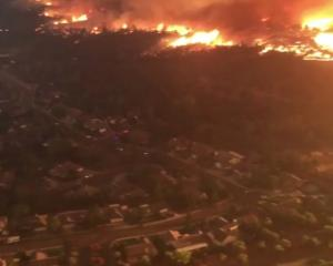Devastating wildfire approaches an area in Redding, California. Photo: Reuters