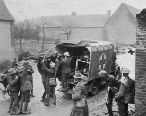 Wounded New Zealanders are put into the ambulance at a casualty clearing station on the Western...