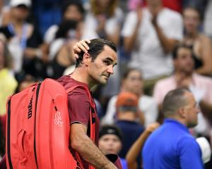 Roger Federer leaves the court after his loss to John Millman. Photo: Danielle Parhizkaran-USA...