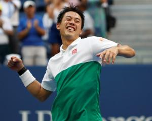 Kei Nishikori celebrates his victory over Marin Cilic. Photo: Geoff Burke-USA TODAY Sports