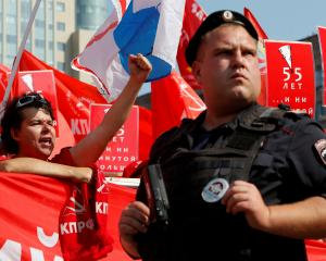 A man shouts slogans during a protest against a proposed increase of the retirement age in Moscow...