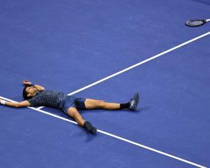 Novak Djokovic of Serbia celebrates match point against Juan Martin Del Potro of Argentina in the...