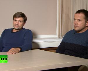A still image shows two Russian men with the same names as those accused by Britain over Skripal...