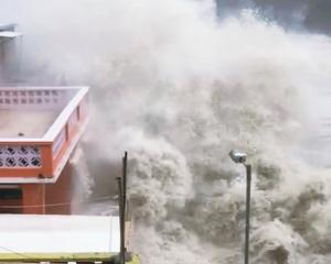 A giant wave strikes the coast in Hong Kong during Typhoon Mangkhut. Photo:  JENNIFER POLLARD/via...