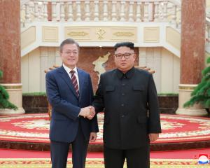 South Korean President Moon Jae-in shakes hands with North Korean leader Kim Jong Un. Photo: Reuters