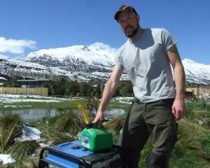 Self-sufficient: Scheelite Ave resident James Pocock with his generator. Photo: Mountain Scene