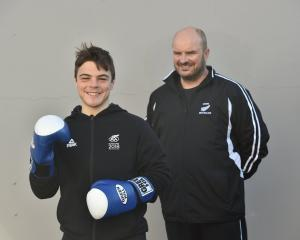 Boxer Kasib Murdoch and coach Bryan Usher have been busy training for the Youth Olympics in...