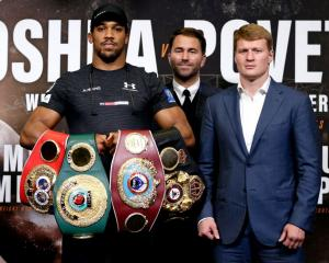 Anthony Joshua (left), Eddie Hearn (middle) and Alexander Povetkin at the press conference prior...