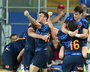 Pumas celebrate their win over the Wallabies last night. Photo: Getty Images