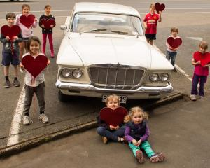 Local Heart Kids with a 1962 S Series Chrysler Valiant, which is appearing at the Autospectacular...