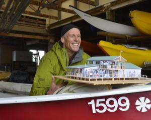 Broad Bay Boating Club rebuild committee member Chris Charteris-Wright shows off a model of the...
