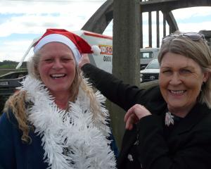 Clutha District Council community support and development adviser Jean Proctor (right) has handed...