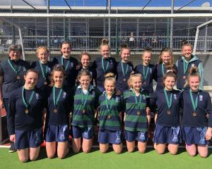 The Columba College First XI hockey team with the bronze medals the side won at the Marie Fry...