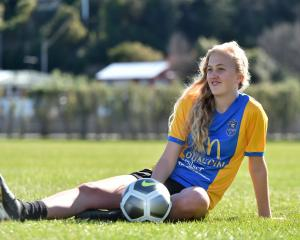 Southern United player Emily Morison (19) enjoys the sun at Logan Park yesterday as she prepares...