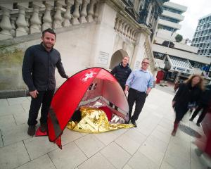 Inventors (from left) Craig Latimer, Braedan Trompetter and Tony  Watts in Dunedin's Octagon this...