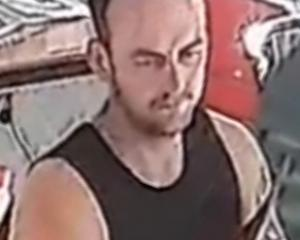 A still taken from CCTV footage shows a man taking a charity collection jar from the counter of...