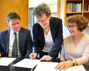 Goethe Institut national German adviser Heike Papenthin signs a scholarship agreement with John...