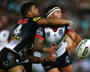 Jazz Tevaga of the Warriors is tackled during the NRL Elimination Final match between the Penrith...
