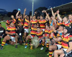 Waikato players celebrate their history repeating feat of taking the Ranfurly Shield off...