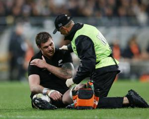 Liam Squire receives medical attention during the match between the All Blacks and the Springboks...