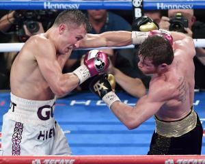 Gennady Golovkin (left) and Canelo Alvarez battle in the ninth round of their WBC/WBA...