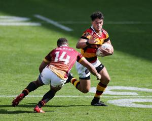 Southland wing Isaac Te Tamaki prepares to tackle Waikato centre Quinn Tupaea during their  Mitre...