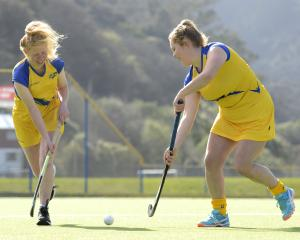 Southern Storm defenders Julia Boothroyd (left) and Aleisha Rainey get in some practice at the...