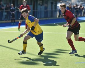 Southern Dogs' Finn Ward attempts to cross with Canterbury Cavaliers' Andrew Ross in pursuit...