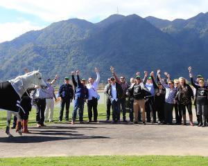 Members of the Frosty's  Shoutin The Beers Great Northern Hurdles syndicate celebrate in style at...