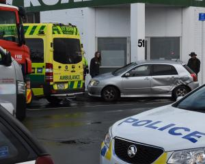 Emergency services at the scene of a crash in South Dunedin, Photo: Stephen Jaquiery