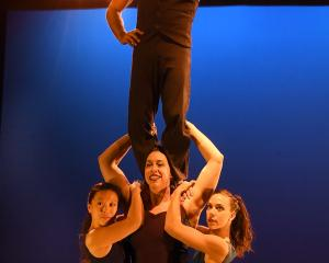 Casus Circus performer Sarah McDougall holds up Mayu Moto (left), Shannon Vitali (right) and...