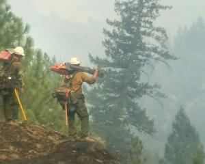 Firefighters at the Mendocino fire in Northern California take stock of where to create fire...
