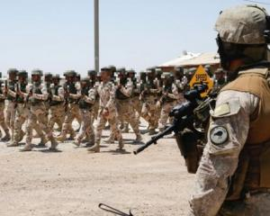 A New Zealand Defence Force protection soldier observes troops of the Iraqi Security Forces in...